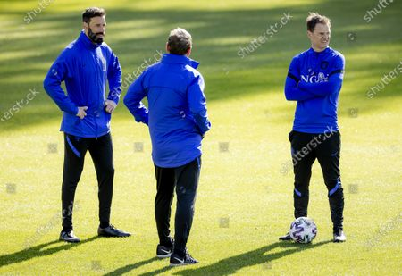 Stock Photo of Dutch national soccer team head coach Frank de Boer (R) and assistant coach Ruud van Nistelrooij (L) lead their team's training session in Zeist, Netherlands, 29 March 2021. The Netherlands will face Gibraltar in their FIFA World Cup 2022 qualifying soccer match on 30 March 2021.
