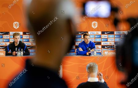 Stock Picture of Dutch national soccer team head coach Frank de Boer (R) and Frenkie de Jong (L) attend a press conference in Zeist, Netherlands, 29 March 2021. The Netherlands will face Gibraltar in their FIFA World Cup 2022 qualifying soccer match on 30 March 2021.