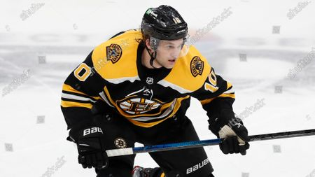 Boston Bruins' Anders Bjork plays against the New Jersey Devils during the second period of an NHL hockey game, in Boston