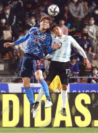 Lucas Gonzales (R) of Argentina in action against Koki Machida (L) of Japan during the U-24 international friendly soccer match between Japan and Argentina at Kitakyushu Stadium in Fukuoka, south-western Japan, 29 March 2021.