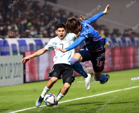 Fernando Valenzuela (L) of Argentina in action against Koki Machida (R) of Japan during the U-24 international friendly soccer match between Japan and Argentina at Kitakyushu Stadium in Fukuoka, south-western Japan, 29 March 2021.