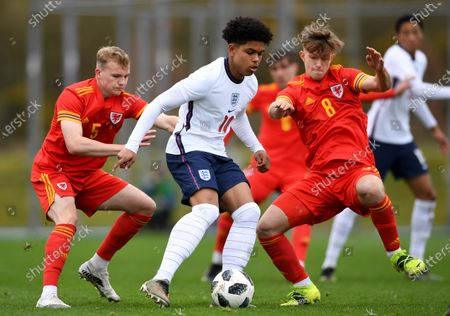Shola Shoretire of England is challenged by Taylor Jones (5) and Oli Ewing (8) of Wales