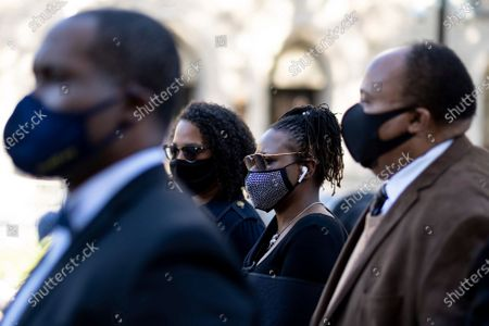 Georgia State Rep. Park Cannon, D-Atlanta, center, walks beside Martin Luther King, III, as she returns to the State Capitol in Atlanta on Monday morning, after being arrested last week for knocking on the governor's office door as he signed voting legislation