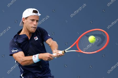 Diego Schwartzman of Argentina in action against Adrian Mannarino of France during their Men's singles match at the Miami Open tennis tournament in Miami Gardens, Florida, USA, 29 March 2021.