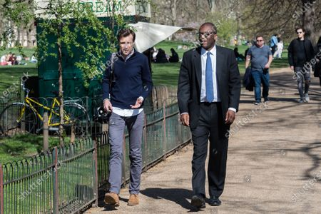 LONDON, UNITED KINGDOM - MARCH 29, 2021: Secretary of State for Business, Energy and Industrial Strategy Kwasi Kwarteng (R) walks in the sunny weather in St James's Park as Coronavirus lockdown restrictions are eased across England, on 29 March, 2021 in London, England. Under the government's four stage plan to unlock the country as the vaccination programme progresses and Covid-19 infection rates continue to fall further relaxation of restrictions is expected on 12 April.