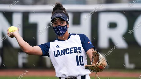 Stock Picture of Longwood's Lauren Taylor throws the ball during an NCAA college softball game against Winthrop, in Rock Hill, S.C. Longwood won 6-4