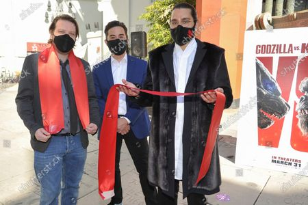Film directors Gareth Edwards, from left, Adam Wingard and Jordan Vogt-Roberts attend a ceremony celebrating the re-opening of the TCL Chinese Theatre in Los Angeles, following its closure due to the Covid pandemic
