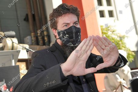 Film director Adam Wingard attends a ceremony celebrating the re-opening of the TCL Chinese Theatre in Los Angeles, following its closure due to the Covid pandemic