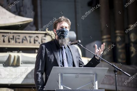Adam Wingard delivers a speech on stage during the post-pandemic reopening and ribbon cutting ceremony hosted by TCL Chinese Theatre in Hollywood, California, USA, 29 March 2021.