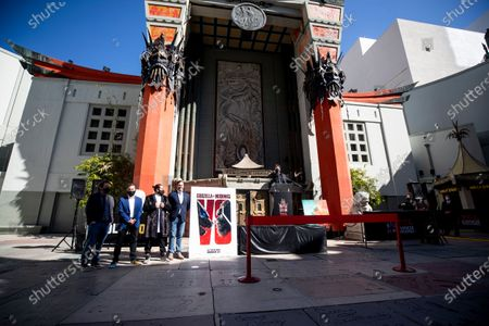 Adam Wingard (R) delivers a speech on stage during the post-pandemic reopening and ribbon cutting ceremony hosted by TCL Chinese Theatre in Hollywood, California, USA, 29 March 2021.