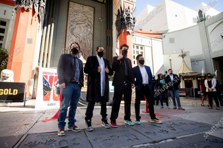 Gareth Edwards, Jordan Vogt-Roberts, Adam Wingard and Michael Dougherty pose after cutting the red ribbon during the post-pandemic reopening and ribbon cutting ceremony hosted by TCL Chinese Theatre in Hollywood, California, USA, 29 March 2021.