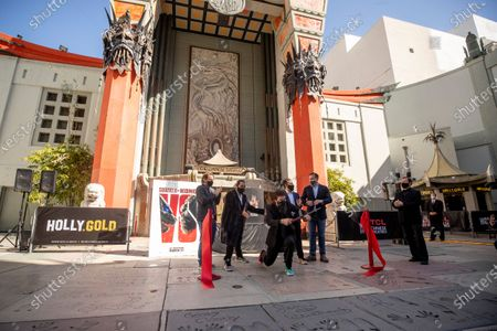 Gareth Edwards, Jordan Vogt-Roberts, Adam Wingard, Michael Dougherty, and CEO of Legendary Entertainment Joshua Grode react after cutting the red ribbon during the post-pandemic reopening and ribbon cutting ceremony hosted by TCL Chinese Theatre in Hollywood, California, USA, 29 March 2021.