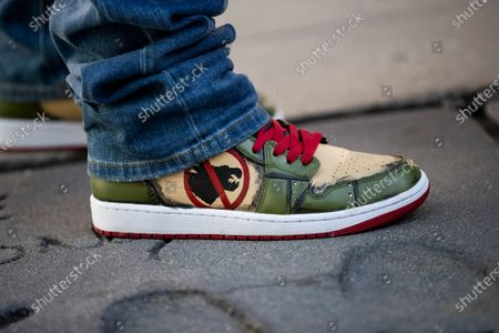Gareth Edwards wears a pair of snickers designed in relation to the Godzilla vs. Kong movie during the post-pandemic reopening and ribbon cutting ceremony hosted by TCL Chinese Theatre in Hollywood, California, USA, 29 March 2021.