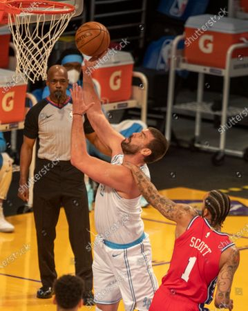 Lakers center Marc Gasol shoots a basket past 76ers forward Mike Scott in the first half at Staples Center on Thursday, March 25, 2021 in Los Angeles, CA. (Allen J. Schaben / Los Angeles Times)