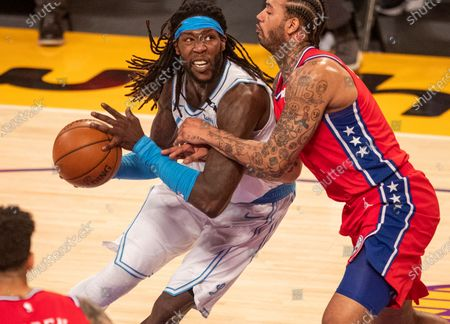 Stock Photo of Lakers forward Montrezl Harrell, #25, left, who had 20 points, drives past 76ers forward Mike Scott, right, in the first half at Staples Center on Thursday, March 25, 2021 in Los Angeles, CA. Lakers lost 101-109. (Allen J. Schaben / Los Angeles Times)