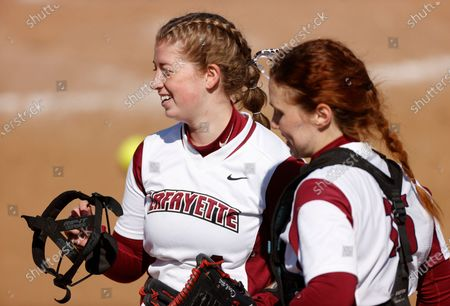 Lafayette pitcher Hannah Cook, left, celebrates a strike-out with catcher Grace Harvey while facing Bucknell during an NCAA softball game, in Easton, Pa