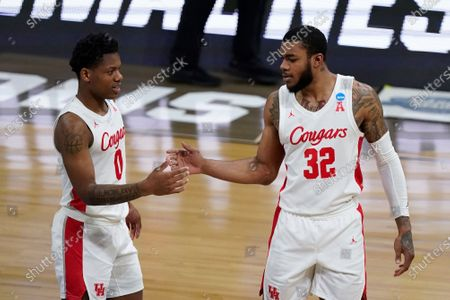 Houston guard Marcus Sasser (0) and Houston forward Reggie Chaney (32) react to a play against Oregon State during the second half of an Elite 8 game in the NCAA men's college basketball tournament at Lucas Oil Stadium, in Indianapolis