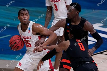 Stock Photo of Houston forward Fabian White Jr. grabs a rebound in front of Oregon State forward Warith Alatishe, right, and guard Gianni Hunt (0) during the second half of an Elite 8 game in the NCAA men's college basketball tournament at Lucas Oil Stadium, in Indianapolis