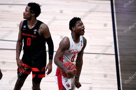 Stock Picture of Houston guard Marcus Sasser, right, celebrates as Oregon State guard Gianni Hunt (0) looks on during the second half of an Elite 8 game in the NCAA men's college basketball tournament at Lucas Oil Stadium, in Indianapolis. Houston won 67-61