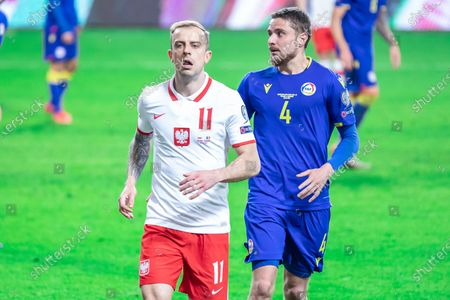 Kamil Grosicki of Poland and Marc Rebes of Andorra in action during the FIFA World Cup 2022 Qatar qualifying match between Poland and Andorra at Marshal Jozef Pilsudski Legia Warsaw Municipal Stadium.  (Final score; Poland 3:0 Andorra)