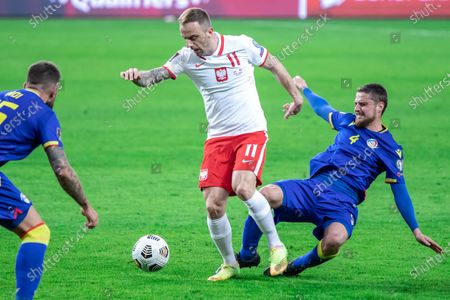 Stock Picture of Kamil Grosicki of Poland and Marc Rebes of Andorra in action during the FIFA World Cup 2022 Qatar qualifying match between Poland and Andorra at Marshal Jozef Pilsudski Legia Warsaw Municipal Stadium.  (Final score; Poland 3:0 Andorra)