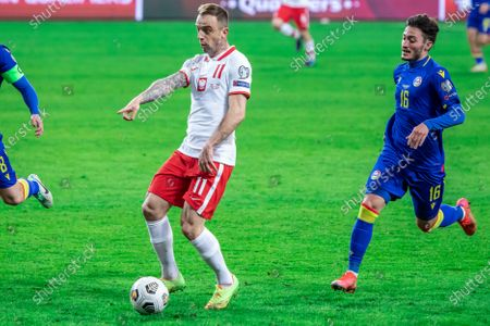 Kamil Grosicki of Poland and Alex Martinez, of Andorra in action during the FIFA World Cup 2022 Qatar qualifying match between Poland and Andorra at Marshal Jozef Pilsudski Legia Warsaw Municipal Stadium.  (Final score; Poland 3:0 Andorra)