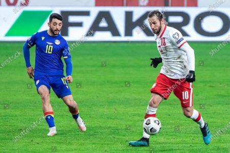 Jordi Alaez of Andorra and Grzegorz Krychowiak of Poland in action during the FIFA World Cup 2022 Qatar qualifying match between Poland and Andorra at Marshal Jozef Pilsudski Legia Warsaw Municipal Stadium.  (Final score; Poland 3:0 Andorra)