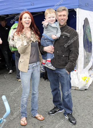 Stock Image of Happy Mondays' Bez with partner Monica Ward and son