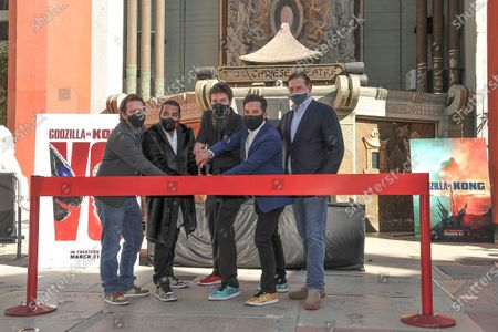 Gareth Edwards, from left, Jordan Vogt-Roberts, Adam Wingard, Michael Dougherty and Joshua Grode attends a ceremony celebrating the re-opening of the TCL Chinese Theatre in Los Angeles, following its closure due to the Covid pandemic