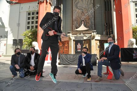 Stock Picture of Gareth Edwards, from left, Jordan Vogt-Roberts, Adam Wingard, Michael Dougherty and Joshua Grode attends a ceremony celebrating the re-opening of the TCL Chinese Theatre in Los Angeles, following its closure due to the Covid pandemic