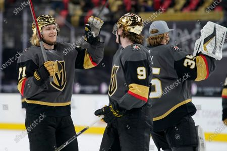 Vegas Golden Knights center William Karlsson (71) and center Cody Glass (9) celebrate after defeating the Los Angeles Kings in an NHL hockey game, in Las Vegas
