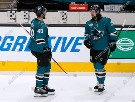 San Jose Sharks defenseman Erik Karlsson (65) is congratulated by teammate Tomas Hertl (48) after scoring the winning goal against the Minnesota Wild in a shootout in an NHL hockey game in San Jose, Calif
