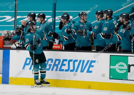 San Jose Sharks defenseman Erik Karlsson (65) is congratulated by the bench after scoring a goal against the Minnesota Wild during the second period of an NHL hockey game in San Jose, Calif