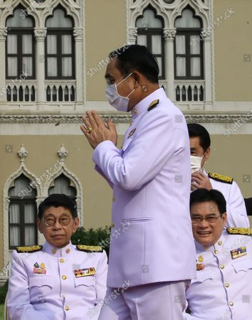 Thai Prime Minister Prayut Chan-o-cha (C) greets to his cabinet during a group photo after a cabinet reshuffle, at Government House in Bangkok, Thailand, 30 March 2021. The new Thai government named three new ministers to replace vacant positions. The reshuffle comes in the wake of a 24 February court ruling that convicted former Education Minister Nataphol Teepsuwan, Digital Economy and Society Minister Buddhipongse Punnakanta and Deputy Transport Minister Thaworn Senneam guilty of protesting against the government of former Prime Minister Yingluck Shinawatra in 2013-14. The new Thai government will face increasing political tension as the anti-government and pro-democracy movement holds protests across Thailand. Chan-o-cha is the leader of the military junta which has governed Thailand since 22 May 2014.