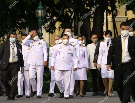 The Thai cabinet arrives for a group photo after a cabinet reshuffle, at Government House in Bangkok, Thailand, 30 March 2021. The new Thai government named three new ministers to replace vacant positions. The reshuffle comes in the wake of a 24 February court ruling that convicted former Education Minister Nataphol Teepsuwan, Digital Economy and Society Minister Buddhipongse Punnakanta and Deputy Transport Minister Thaworn Senneam guilty of protesting against the government of former Prime Minister Yingluck Shinawatra in 2013-14. The new Thai government will face increasing political tension as the anti-government and pro-democracy movement holds protests across Thailand. Chan-o-cha is the leader of the military junta which has governed Thailand since 22 May 2014.