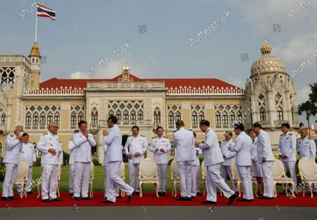 Stock Picture of Thai Prime Minister Prayut Chan-o-cha (C-L) greets his cabinet during a group photo session after a cabinet reshuffle, at Government House in Bangkok, Thailand, 30 March 2021. The new Thai government named three new ministers to replace vacant positions. The reshuffle comes in the wake of a 24 February court ruling that convicted former Education Minister Nataphol Teepsuwan, Digital Economy and Society Minister Buddhipongse Punnakanta and Deputy Transport Minister Thaworn Senneam guilty of protesting against the government of former Prime Minister Yingluck Shinawatra in 2013-14. The new Thai government will face increasing political tension as the anti-government and pro-democracy movement holds protests across Thailand. Chan-o-cha is the leader of the military junta which has governed Thailand since 22 May 2014.