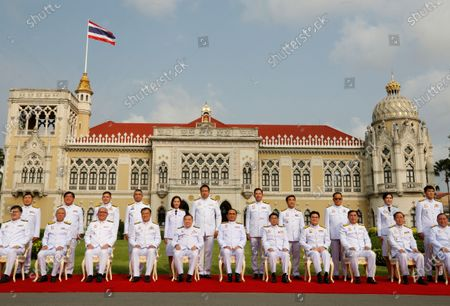 Thai Prime Minister Prayut Chan-o-cha (C) and his cabinet pose during a group photo after a cabinet reshuffle, at Government House in Bangkok, Thailand, 30 March 2021. The new Thai government named three new ministers to replace vacant positions. The reshuffle comes in the wake of a 24 February court ruling that convicted former Education Minister Nataphol Teepsuwan, Digital Economy and Society Minister Buddhipongse Punnakanta and Deputy Transport Minister Thaworn Senneam guilty of protesting against the government of former Prime Minister Yingluck Shinawatra in 2013-14. The new Thai government will face increasing political tension as the anti-government and pro-democracy movement holds protests across Thailand. Chan-o-cha is the leader of the military junta which has governed Thailand since 22 May 2014.