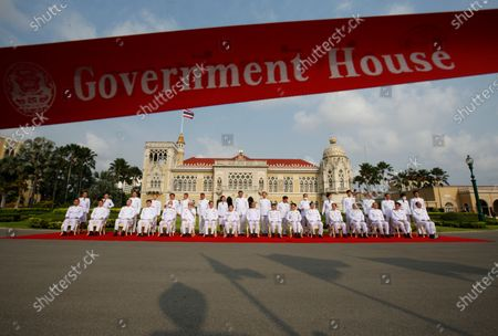 Stock Photo of Thai Prime Minister Prayut Chan-o-cha (C) and his cabinet pose during a group photo after a cabinet reshuffle, at Government House in Bangkok, Thailand, 30 March 2021. The new Thai government named three new ministers to replace vacant positions. The reshuffle comes in the wake of a 24 February court ruling that convicted former Education Minister Nataphol Teepsuwan, Digital Economy and Society Minister Buddhipongse Punnakanta and Deputy Transport Minister Thaworn Senneam guilty of protesting against the government of former Prime Minister Yingluck Shinawatra in 2013-14. The new Thai government will face increasing political tension as the anti-government and pro-democracy movement holds protests across Thailand. Chan-o-cha is the leader of the military junta which has governed Thailand since 22 May 2014.