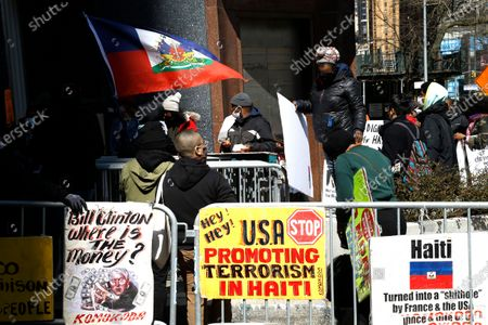 Hatians demonstrate near the United Nations in opposition to their government's authoritarian stand against its own people on March 29, 2021 in New York City. In an effort to consolidate power, President Jovenel Moise is calling for a new constitution that would threaten the existing constitution formed in 1987 which expanded civil liberties and human rights of its citizens.