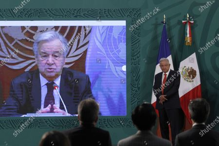 Mexico's President Andres Manuel Lopez Obrador listens to  UN Secretary General Antonio Guterres during  a virtual meeting  as part of the inauguration of the Equality Generation Forum at National Palace on March 29, 2021 in Mexico City, Mexico