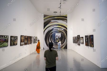 Stock Image of People visit the 'Life @ Home' Royal photo exhibition at the BACC (Bangkok Arts and Culture Center) in Bangkok, Thailand, 30 March 2021. The Royal exhibit showcases photographs taken by Thai Princess Maha Chakri Sirindhorn, mostly focusing on daily life, nature and animals. The exhibition runs until 18 April 2021.