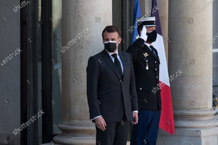 President of the French Republic Emmanuel Macron awaits the arrival of Nechirvan Barzani, President of the Autonomous Region of Iraqi Kurdistan, at the Elysee Palace, in Paris, on March 30, 2021.