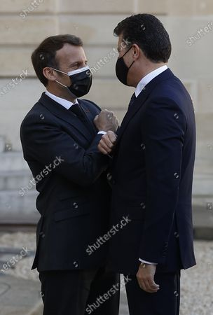 French President Emmanuel Macron (L) greets President of the Kurdistan Region Nechirvan Barzani (R) as he arrives for a meeting at the Elysee Palace in Paris, France, 30 March 2021.