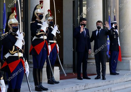 French President Emmanuel Macron (R) greets President of the Kurdistan Region Nechirvan Barzani (L) as he arrives for a meeting at the Elysee Palace in Paris, France, 30 March 2021.