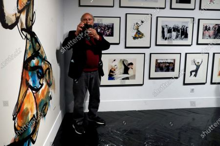 Spanish film maker Carlos Saura takes photographs of the photographer as he poses during the presentation of the exhibition 'Carlos Saura and Dance' at Madrid's Cultural Center Fernan Gomez theatre, in Madrid, Spain, 30 March 2021. The exhibition will run until 06 June 2021.
