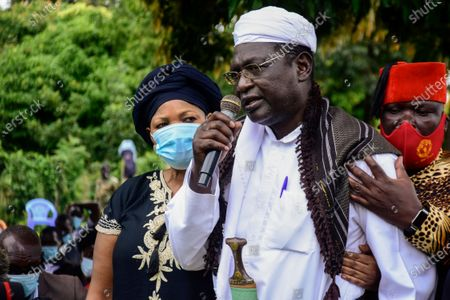 Malik Obama, a half-brother of former U.S. President Barack Obama, speaks at the burial of Sarah Obama, step-grandmother of Barack Obama, at her burial in her home village of Kogelo, in western Kenya . Relatives and officials confirmed on Monday that Sarah Obama, the matriarch of former U.S. President Barack Obama's Kenyan family, has died aged at least 99 years old