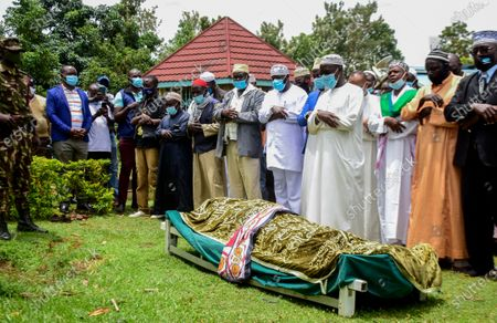 Mourners pray over the body of Sarah Obama, step-grandmother of President Barack Obama, at her burial in her home village of Kogelo, in western Kenya . Relatives and officials confirmed on Monday that Sarah Obama, the matriarch of former U.S. President Barack Obama's Kenyan family, has died aged at least 99 years old