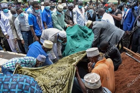 Members of the Muslim community bury the body during the funeral of Sarah Onyango Obama, the step-grandmother of former US president Barack Obama, at her home in Kogelo in western Kenya 30 March 2021. Ninety-nine-year-old Mama Sarah, as she was known, died 29 March 2021 in a small village on the shores of Lake Victoria and was a philanthropist who promoted education for girls and orphans.