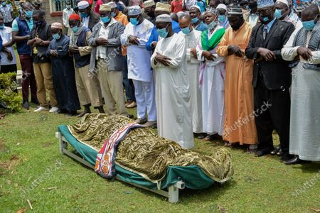 Members of the Muslim community carry out burial rites during the funeral of Sarah Onyango Obama, the step-grandmother of former US president Barack Obama, at her home in Kogelo in western Kenya 30 March 2021. Ninety-nine-year-old Mama Sarah, as she was known, died 29 March 2021 in a small village on the shores of Lake Victoria and was a philanthropist who promoted education for girls and orphans.