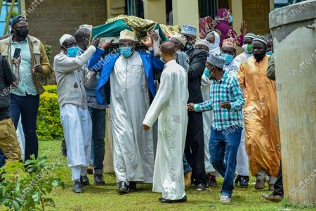 Members of the Muslim community carry the body during the funeral of Sarah Onyango Obama, the step-grandmother of former US president Barack Obama, at her home in Kogelo in western Kenya 30 March 2021. Ninety-nine-year-old Mama Sarah, as she was known, died 29 March 2021 in a small village on the shores of Lake Victoria and was a philanthropist who promoted education for girls and orphans.